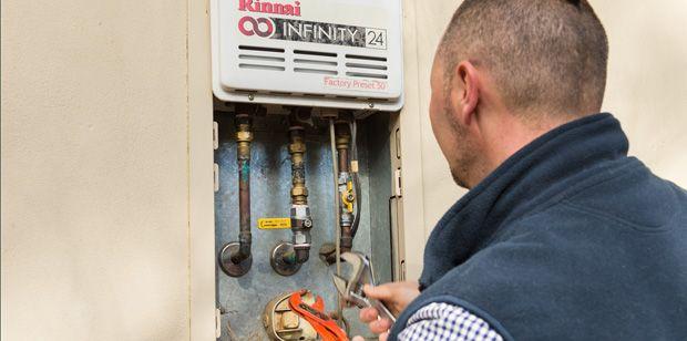 Plumber fixing Rinnai instant hot water